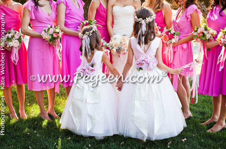 The bride choose Lotus Pink and an Antique White Signature Bustle for her flower girl dress